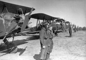 Pilots in front of the Polikarpov PO2 biplane